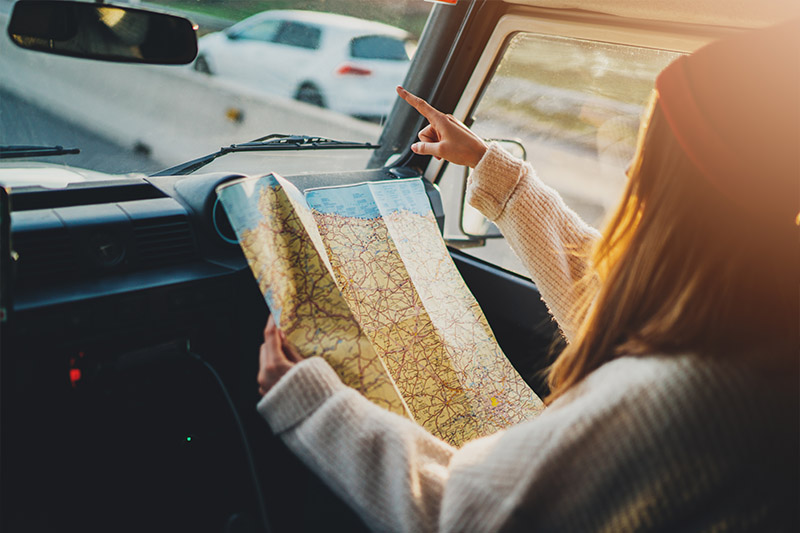 Holding a map in a car