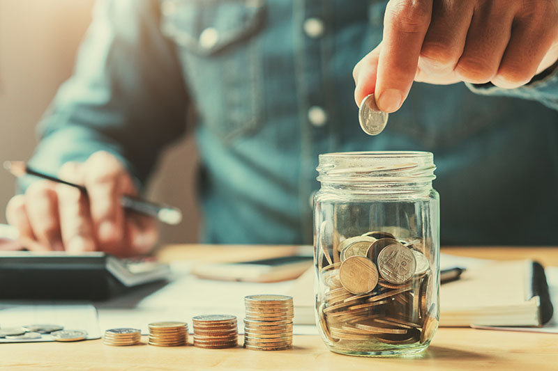 putting money into jar